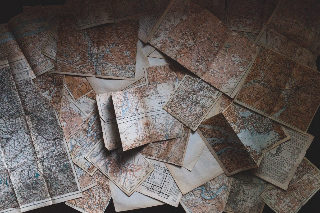 Collection of maps lying on the floor